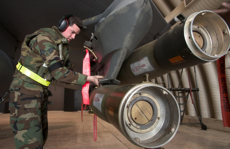 KUNSAN AIR BASE, Republic of Korea  March 26, 2007 -- Senior Airman Jason Cook, 8th Aircraft Maintenance Squadron weapons technician, inspects a Guided Bomb Unit-12 on an F-16 March 26. (Air Force photo/Senior Airman Barry Loo)