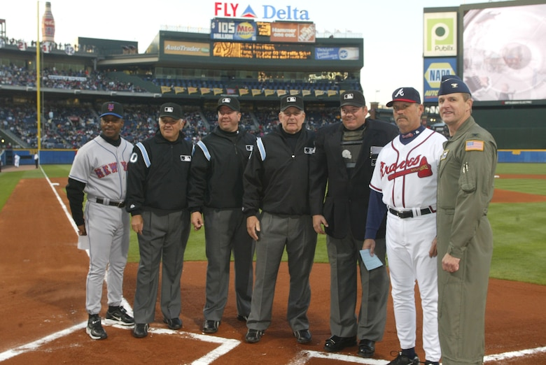 Col. Heath Nuckolls (right), named honorary team captain poses with game officials during the Atlanta Braves opening game. Colonel Nuckolls is the  commander of the 94th Airlift Wing at Dobbins Air Reserve Base, Ga.  April 6, opening game day at Turner Field, in Atlanta, was also the debut of the Air Force 60th Anniversary baseballs that will travel around the world. The baseballs will return to Turner Field within the month of September.  The Heritage to Horizons events throughout the year lead up to Atlanta Air Force Week, Oct. 8-14. (U.S. Air Force photo/Don Peek)