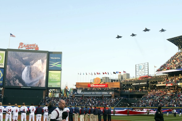 Air Force jets perform a flyby in celebration of the Atlanta Braves baseball opening day at Turner Field on April 6, 2007.  Two F-15 and two F-22 fighter aircraft represent the Heritage to Horizons theme for the Air Force during the performance of the Star-Spangled Banner.  The tribute to the Air Force's 60th Anniversary is represented by baseballs that will make a trip around the world and return to Turner Field in September.  The Heritage to Horizons events throughout the year all lead up to Atlanta Air Force Week, hosted by Air Force Reserve Command, Oct. 8-14, 2007. (U.S. Air Force photo/Don Peek)
