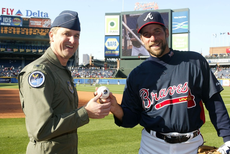 Col. Heath Nuckolls, commander of the Air Force Reserve's 94th Airlift Wing, Dobbins Air Reserve Base, Ga., along with Atlanta Braves pitcher, John Smoltz, present a baseball that will make a trip around the world commemorating the Air Force's 60th Anniversary at the April 6, 2007, opening home game at Turner Field. The baseball will return to Turner Field during a September home game. The Heritage to Horizons events throughout year lead up to Atlanta Air Force Week, hosted by Air Force Reserve Command, Oct. 8-14, 2007. (U.S.Air Force photo/Don Peek)