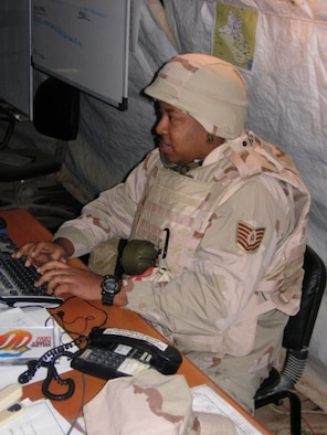 Tech. Sgt. Robert Cade, 44 APS, works on the GATES system to verify flight information while deployed to Tall Afar, Iraq. (Courtesy photo)