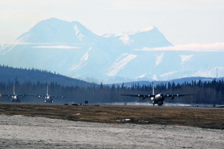 EIELSON AIR FORCE BASE, Alaska -- Two C-130 and one C-160 aircraft from the Armee de l'Air (French Air Force), take off for a mission during Red Flag-Alaska 07-1 here on April 10. Red Flag-Alaska is a Pacific Air Forces-directed field training exercise for U.S. forces flown under simulated air combat conditions. It is conducted on the Pacific Alaskan Range Complex with air operations flown out of Eielson and Elmendorf Air Force Bases.