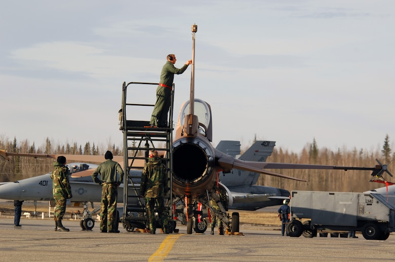 EIELSON AIR FORCE BASE, Alaska -- Maintainers from the 64th Aggressor Squadron, Nellis Air Force Base, Nevada, prep an F-16 prior to a mission during Red Flag-Alaska 07-1 here on April 10. Red Flag-Alaska is a Pacific Air Forces-directed field training exercise for U.S. forces flown under simulated air combat conditions. It is conducted on the Pacific Alaskan Range Complex with air operations flown out of Eielson and Elmendorf Air Force Bases. 