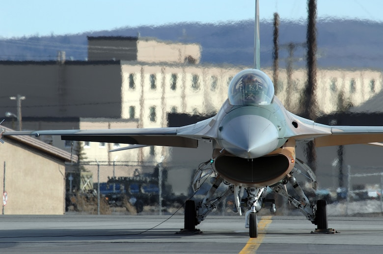 EIELSON AIR FORCE BASE, Alaska -- An F-16 Fighting Falcon from the 64th Aggressor Squadron, Nellis Air Force Base, Nevada prepares to take off for a mission during Red Flag-Alaska 07-1 here on April 10. Red Flag-Alaska is a Pacific Air Forces-directed field training exercise for U.S. forces flown under simulated air combat conditions. It is conducted on the Pacific Alaskan Range Complex with air operations flown out of Eielson and Elmendorf Air Force Bases. 
