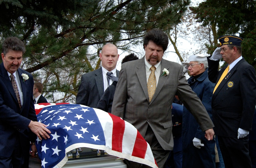 """(March 28, 2007, Logan, Utah), Terry J. Nielsen, his brother and family members carry the body of their deceased father Lt. Colonel Chase J. Nielsen to his final resting place in the city cemetery of Hyrum, Utah.  Lt. Col Nielsen was one of the last remaining members of the famed """"Doolittle Raiders"""". The members of the """"Doolittle Raiders"""" reached national acclaim in 1942 after launching the first successful aerial bombing raid on Tokyo, Japan in retaliation for the Japanese bombing of Pearl Harbor, Hawaii in December of 1941. (USAF Photo by Efrain Gonzalez, 75 Communications Squadron)"""