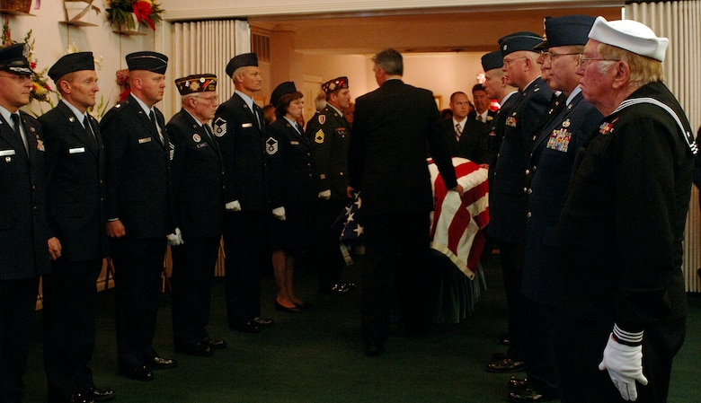 "(March 28, 2007, Logan, Utah), Veterans from VFW Post1695, the VFW Post 8307 and active duty military members attending Lt. Colonel Chase J. Nielsen memorial service pay their final respects to one of Utah's most famous WWII veteran and hero.  Lt. Col Nielsen was one of the last remaining members of the famed ""Doolittle Raiders"". The members of the ""Doolittle Raiders"" reached national acclaim in 1942 after launching the first successful aerial bombing raid on Tokyo, Japan in retaliation for the Japanese bombing of Pearl Harbor, Hawaii in December of 1941. (USAF Photo by Efrain Gonzalez, 75 Communications Squadron)"