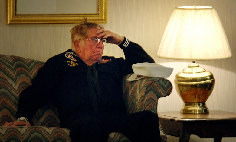 "(March 28, 2007, Logan, Utah), Willie Hunsaker, retired US Navy SEABEE and member of the VFW Post 1695 from Brigham City, Utah, mourns the loss of Lt. Colonel Chase J. Nielsen, Utah's most famous WWII veteran and hero. Lt. Colonel Nielsen was more than a hero to the members of VFW Post 1695; he was also a long time member of their post and a beloved friend.  Lt. Col Nielsen was one of the last remaining members of the famed ""Doolittle Raiders"". The members of the ""Doolittle Raiders"" reached national acclaim in 1942 after launching the first successful aerial bombing raid on Tokyo, Japan in retaliation for the Japanese bombing of Pearl Harbor, Hawaii in December of 1941. (USAF Photo by Efrain Gonzalez, 75 Communications Squadron)"