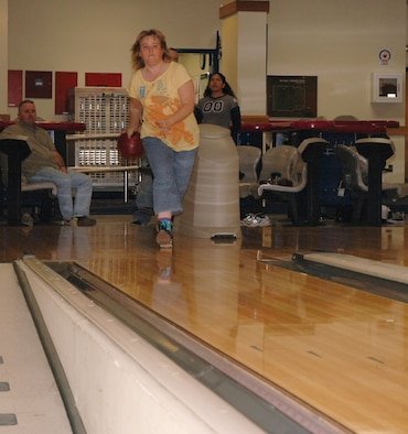 OSAN AIR BASE, Republic of Korea --  Michelle Buffington throws a strike at the MiG Alleys Bowling Center here Tuesday. The bowling center offers open bowl specials all week, with Red Head Pin Bowling from 11 a.m. to 5 p.m. Tuesdays. (U.S. Air Force photo by Staff Sgt. Benjamin Rojek)