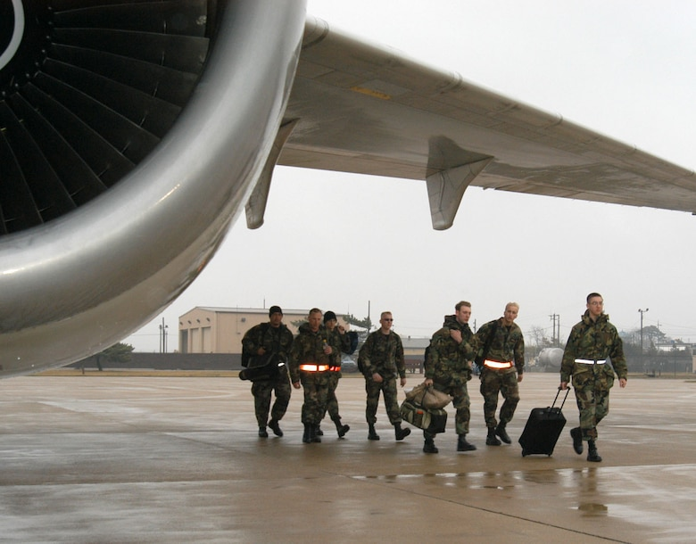 KUNSAN AIR BASE, Republic of Korea  April 13, 2007 -- Airmen assigned to the 9th Expeditionary Fighter Squadron make their way to an awaiting DC-10 bound for Holloman Air Force Base, N.M. here. The Airmen's redeployment culminates their four-month air expeditionary force deployment in the Republic of Korea. (U.S. Air Force photo/Senior Airman Stephen Collier)