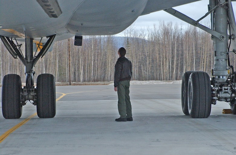 EIELSON AIR FORCE BASE, Alaska--Tech. Sgt. David Seyl, 9th Air Refueling Squadron flight engineer, performs post-flight safety checks on a KC-10 Extender after a Red Flag-Alaska 07-1 refueling flight April 11. The KC-10 can transport up to 75 people and nearly 170,000 pounds of cargo a distance of about 4,400 miles unrefueled.(U.S. Air Force photo by Senior Airman Justin Weaver).