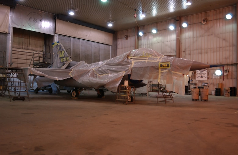 EIELSON AIR FORCE BASE, Alaska -- 'ICEMAN One', the 354th Wing Commanders' F-16 Fighting Falcon, receives a new tail design and a paint touch up here April 11.  The paint job will help prevent future corrosion.  (U.S. Air Force Photo by Airman 1st Class Jonathan Snyder)