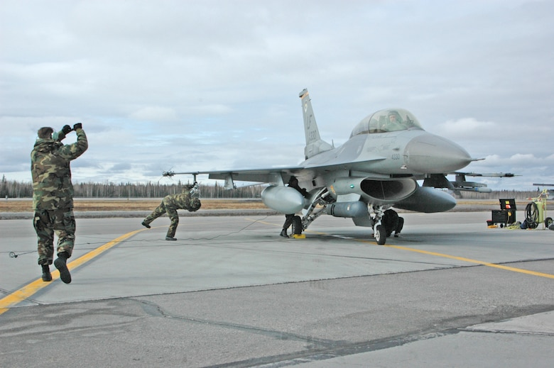 EIELSON AIR FORCE BASE, Alaska--Airmen from the 61st Fighter Squadron catch a Luke F-16 on the flightline at Eielson Air Force Base, Alaska during Red Flag-Alaska 07-1 here April 11. Red Flag-Alaska is a Pacific Air Forces-directed field training exercise for U.S. forces flown under simulated air combat conditions. It is conducted on the Pacific Alaskan Range Complex with air operations flown out of Eielson and Elmendorf Air Force Bases.(U.S. Air Force photo by Tech. Sgt. William Farrow).