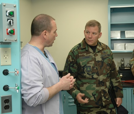 Chief Master Sgt. Steve Sargent, 341st Space Wing command chief, discusses lab practices with Tech. Sgt. Richard Petrucci, dental lab technician, during a tour of the clinic April 9.