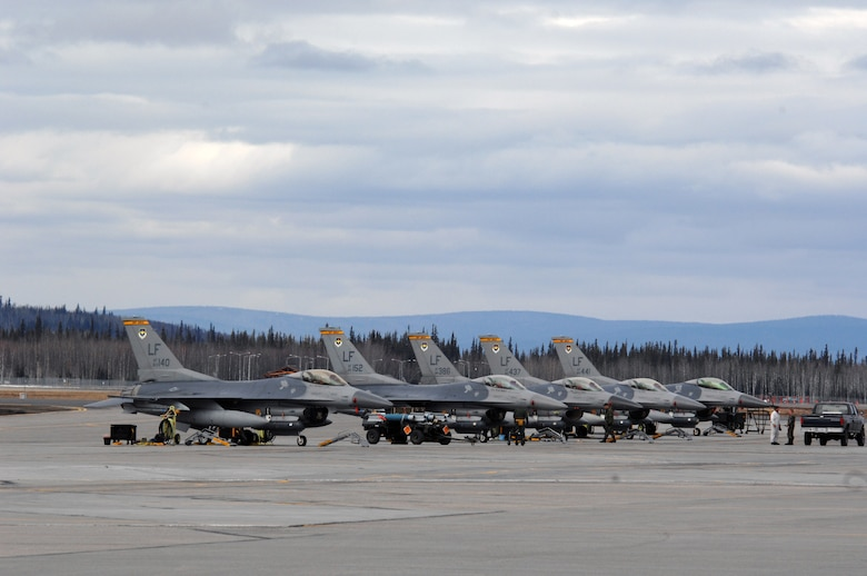 EIELSON AIR FORCE BASE, Alaska -- F-16 Fighting Falcon aircraft from the 61st Fighter Squadron, Luke Air Force Base, Arizona are readied for take off prior to  missions during Red Flag-Alaska 07-1 here on April 11. Red Flag-Alaska is a Pacific Air Forces-directed field training exercise for U.S. forces flown under simulated air combat conditions. It is conducted on the Pacific Alaskan Range Complex with air operations flown out of Eielson and Elmendorf Air Force Bases.  (U.S. Air Force Photo by Staff Sgt Joshua Strang)