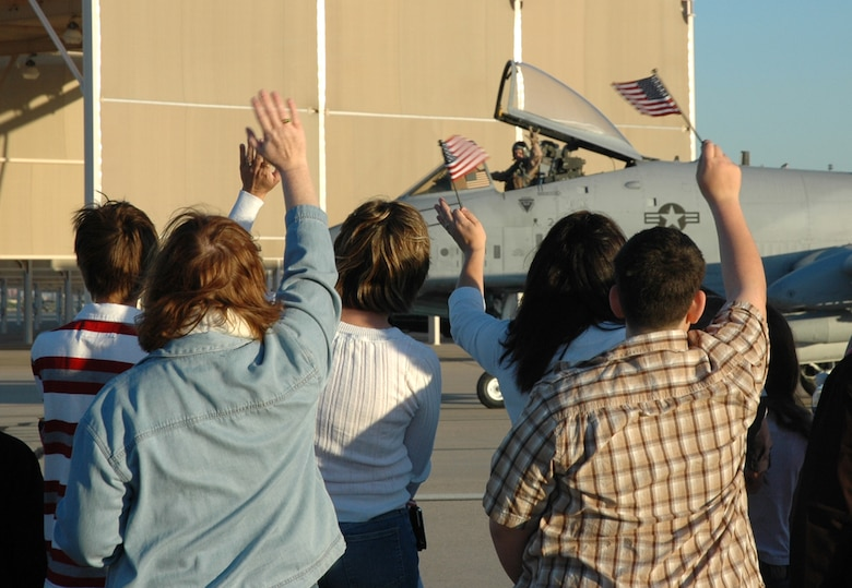Friends and family exchange farewell waves with an A-10 pilot from the 354th Fighter Squadron here, as he makes his way to the runway for takeoff. Twelve pilots from the 354th FS left for Afghanistan April 7, as part of a larger D-M deployment in support of Operation Enduring Freedom. (U.S. Air Force photo/Airman 1st Class Melissa Taeu)