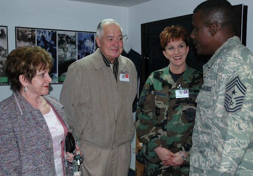 RAMSTEIN AIR BASE, GERMANY -- US Air Forces in Europe Command Chief Master Sgt. Gary Coleman, talks with Senior Master Sgt. Debbie Pietrowski, 52nd Communications Squadron, and her parents at the Parish Enlisted Heritage Room March 29. (Photo by Master Sgt. Chuck Roberts)