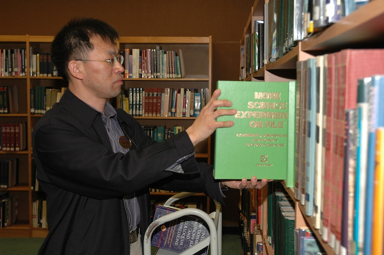 OSAN AIR BASE, Republic of Korea --  Mr. Pae, Hyon chong, reshelves books at the Osan Base Library before they open Thursday. The library has six employees and three volunteers that do everything from putting the books in order to ciculating old books. (U.S. Air Force photo by Staff Sgt. Benjamin Rojek)