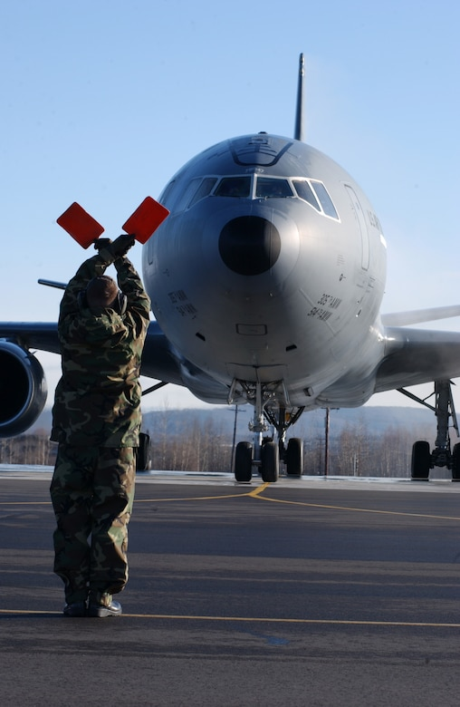 EIELSON AIR FORCE BASE, Alaska -- Staff Sgt. Martin Walker, 305th Maintenance Squadron, McGuire AFB, N.J., proceeds into place to marshal a KC-10 Extender on April 13 during Red Flag-Alaska 07-1. Red Flag-Alaska is a Pacific Air Forces-directed field training exercise for U.S. forces flown under simulated air combat conditions. It is conducted on the Pacific Alaskan Range Complex with air operations flown out of Eielson and Elmendorf Air Force Bases. (U.S. Air Force Photo by Airman 1st Class Jonathan Snyder)