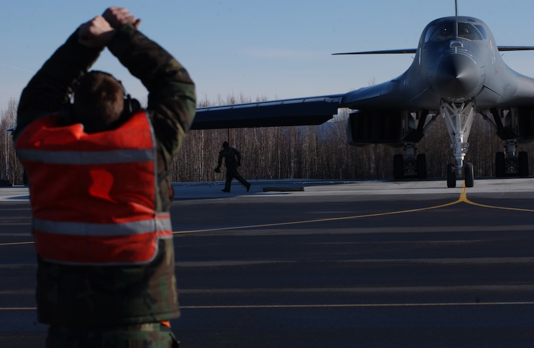 EIELSON AIR FORCE BASE, Alaska -- Senior Airman Michael Anderson, 28th Aircraft Maintenance Squadron, Ellsworth Air Force Base, S.D., marshals a B-1B Lancer on April 13 during Red Flag-Alaska 07-1. Red Flag-Alaska is a Pacific Air Forces-directed field training exercise for U.S. forces flown under simulated air combat conditions. It is conducted on the Pacific Alaskan Range Complex with air operations flown out of Eielson and Elmendorf Air Force Bases. (U.S. Air Force Photo by Airman 1st Class Jonathan Snyder)