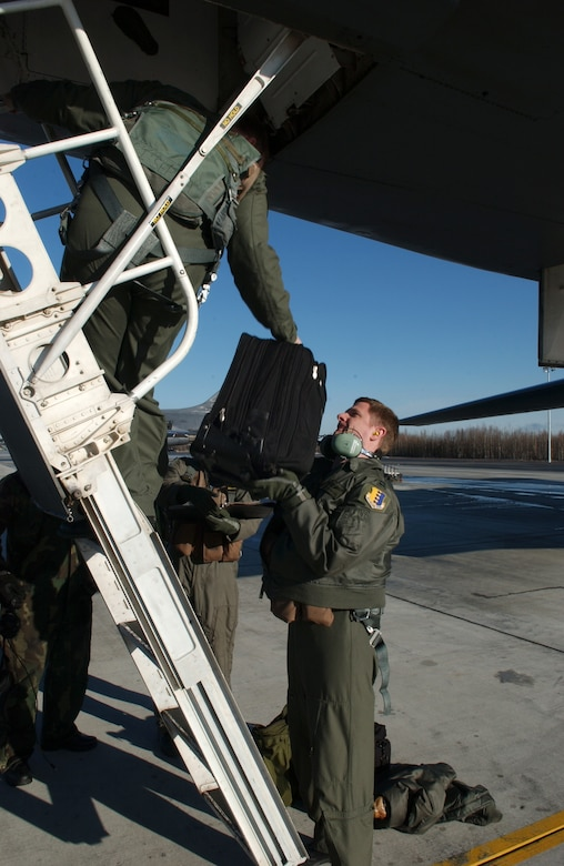 EIELSON AIR FORCE BASE, Alaska -- Capt. Brian Crawford and Capt. Nate Quinlan, 37th Bomb Squadron pilots, Ellsworth Air Force Base, S.D., load their luggage into a B-1B Lancer on April 13 during Red Flag-Alaska 07-1. Red Flag-Alaska is a Pacific Air Forces-directed field training exercise for U.S. forces flown under simulated air combat conditions. It is conducted on the Pacific Alaskan Range Complex with air operations flown out of Eielson and Elmendorf Air Force Bases. (U.S. Air Force Photo by Airman 1st Class Jonathan Snyder)