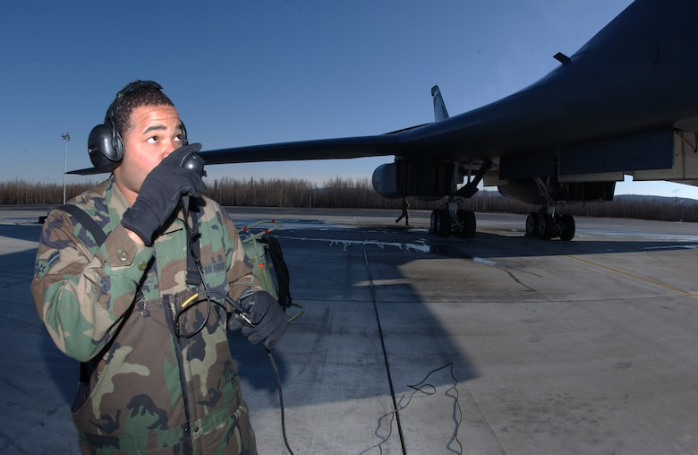 EIELSON AIR FORCE BASE, Alaska -- Airman 1st Class Willis Octavius, 28th Aircraft Maintenance Squadron, Ellsworth Air Force Base, S.D., talks to the pilots of a B-1B Lancer on April 13 during Red Flag-Alaska 07-1. Red Flag-Alaska is a Pacific Air Forces-directed field training exercise for U.S. forces flown under simulated air combat conditions. It is conducted on the Pacific Alaskan Range Complex with air operations flown out of Eielson and Elmendorf Air Force Bases. (U.S. Air Force Photo by Airman 1st Class Jonathan Snyder)