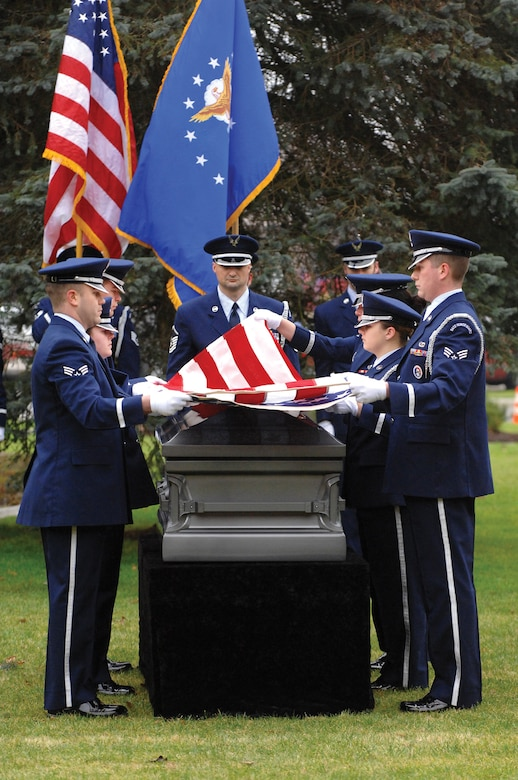 MCCHORD AIR FORCE BASE, Wash.--Members of the base honor guard give the U.S. flag the first of 10 distinctive folds recently during a practice session designed to ensure ceremonial procedures are accurate and comply with all applicable instructions. (U.S. Air Force Photo by Abner Guzman)
