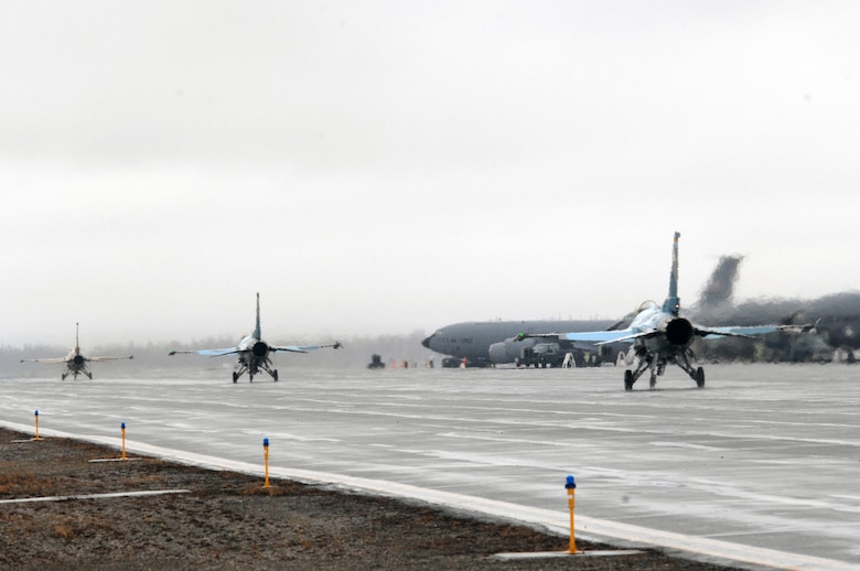 EIELSON AIR FORCE BASE, Alaska -- Three F-16 Fighting Falcons from the 64th Aggressor Squadron, Nellis Air Force Base, Nevada taxi for take off during Red Flag-Alaska 07-1. Red Flag-Alaska is a Pacific Air Forces-directed field training exercise for U.S. forces flown under simulated air combat conditions. It is conducted on the Pacific Alaskan Range Complex with air operations flown out of Eielson and Elmendorf Air Force Bases. 