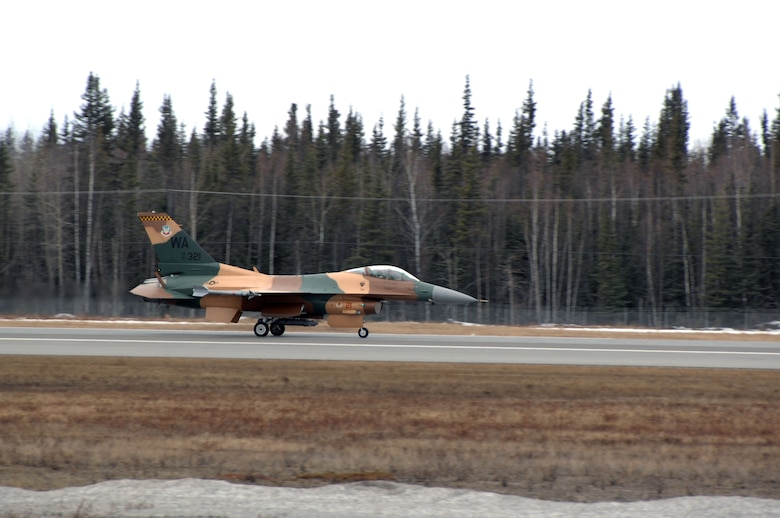 EIELSON AIR FORCE BASE, Alaska -- A 64th Aggressor Squadron F-16 lands after a mission during Red Flag-Alaska 07-1. Red Flag-Alaska is a Pacific Air Forces-directed field training exercise for U.S. forces flown under simulated air combat conditions. It is conducted on the Pacific Alaskan Range Complex with air operations flown out of Eielson and Elmendorf Air Force Bases. 