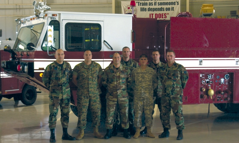 Members of Goodfellow's Military Support for Civilian Authorities team pose in front of one of their fire trucks Wednesday at the Louis F. Garland Department of Defense Fire Academy. From left to right are Master Sgt. Al Medina, Marine Sgt. Taylor Leathers, Staff Sgt. Matt Hare, Staff Sgt. Scott Anderson, Army Staff Sgt. Luis Ruesga, Staff Sgt. Travis Winningham and Staff Sgt. Jason Cunningham, all of the 312th Training Squadron. Not pictured are Staff Sgt. Eric Kunz (the primary driver of the truck) and Navy Petty Officer 2nd Class Victor Torres. (U.S. Air Force photo by Airman 1st Class Stephen Musal)