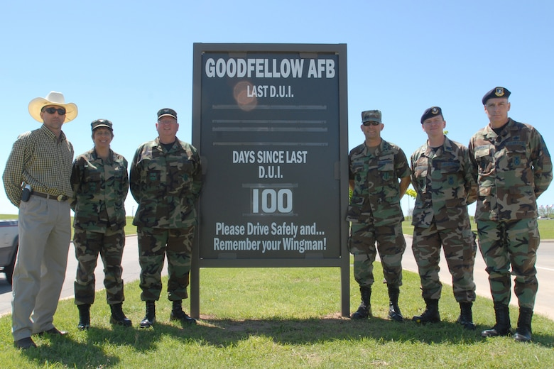 Members of Team Goodfellow's leadership pose Wednesday in front of the sign marking 100 days since the last DUI on Goodfellow. From left to right are Paul Buckingham, Goodfellow's Sexual Assault Response Coordinator; Col. Merrily Madero, 17th Training Wing vice commander; Col. Richard Ayres, 17 TRW commander; Col. Stephen Czerwinski, 17th Mission Support Group commander; Lt. Col. Kenneth O'Neil, 17th Security Forces Squadron commander, and Chief Master Sgt. Michael Murphy, 17 SFS superintendent.