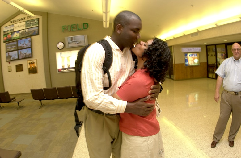 Staff Sgt. Trustin Bey, an instructor with the 316th Training Squadron, is reunited with his wife Sonya April 5 at Mathis Field San Angelo Regional Airport upon returning home from a deployment. Sergeant Bey was assigned to the Combined Joint Special Operations Task Force - Arabian Peninsula, where he served as a radio operator and radio maintenance augmentee for approximately six months with the 5th Special Operations Group from Ft. Campbell, Ky. (U.S. Air Force photo by Airman 1st Class Luis Loza Gutierrez)
