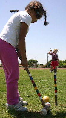 LAUGHLIN AIR FORCE BASE, Texas -- Olivia Winters, daughter of Melissa and Jim Winters,Lear Siegler Incorporated, along with fellow classmates of Texas Hope, a home school group, learn how to play a simple version of croquet during their physical education class on the base football field April 12, 2007. (U.S. Air Force photo by Airman Sara Csurilla)