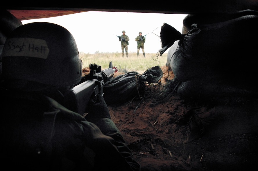 Staff Sgt. Jonathan Hall, 27th Services Squadron, maintains a defensive fighting position in a bunker during Expeditionary Combat Skills training April 5-6.Airmen going to a Central Air Force area of responsibility must complete ECS training before departure. (Air Force photo by Senior Airman Heather Redman)