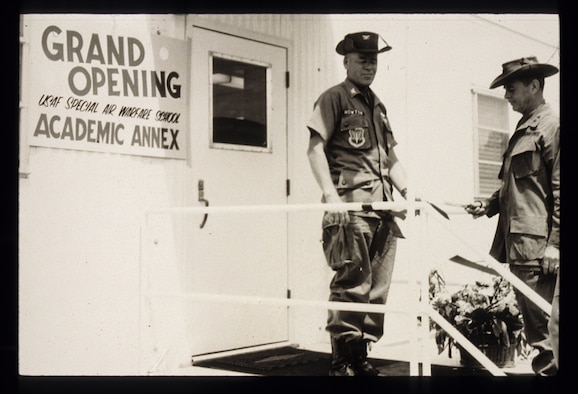 Col. Harry Howton (left), commander of the United States Air Force Special Operations School at the time of its opening, cuts the ribbon for the schoolhouse 40 years ago. Back then, it was known as the Special Air Warfare School. (Courtesy photo)