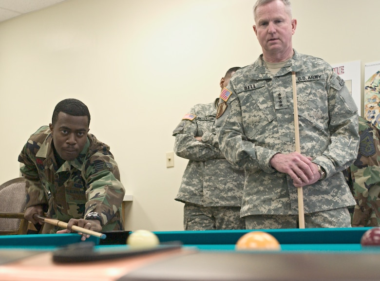 KUNSAN AIR BASE, Republic of Korea  April 10, 2007 -- Senior Airman Bernard Byer, 8th Communications Squadron and Airmen Committed to Excellence president, shoots for the side pocket while playing a game of pool against Gen. B.B. Bell April 10 at the Wolf's ACE in the Hole here. Gen. Bell visited the base for the second time, seeing Airmen and Soldiers perform their mission prior to the base's Operational Readiness Inspection. The general's trip also focused on the concerns and issues the Airmen and Soldiers faced during an assignment at Kunsan. (U.S. Air Force photo/Senior Airman Barry Loo)