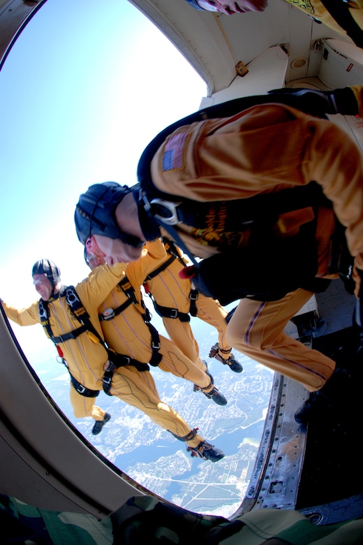 "OVER EGLIN AIR FORCE BASE, Fla. -- U.S. Army Cpl. Ben Borger follows Sgt. Ryan Ray, Sgt. 1st Class Paul Sachs and Sgt. Drew Starr, all members of the U.S. Army Parachute Team ""Golden Knights"" black team, during a jump at the air show practice April 14. The practice show was the only jump the team made due to an April 15 severe weather cancellation of the air show and winds exceeding 20 mph gusts April 16. (U.S. Air Force photo by Staff Sgt. Mike Meares)"