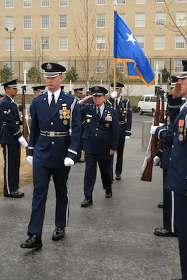 ARLINGTON, Va. -- First Lt. Brent Mundie, Air Force Honor Guard ceremonial guardsman, leads Maj. Gen. Robert Smolen, Air Force District of Washington commander, through the arrival cordon before beginning the Air Force Review ceremony held April 14 at the Air Force memorial.