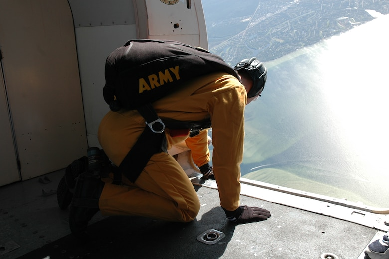 "OVER EGLIN AIR FORCE BASE, Fla. -- U.S. Army Sgt. First Class Paul Sachs, U.S. Army Parachute Team ""Golden Knights"" aerial demonstration team black team leader, takes one final look at the drop zone below the C-41 before being the first of the demonstration team to leap from the plane April 14 during the practice show. The practice show was the only jump the team made due to an April 15 severe weather cancellation of the air show and winds exceeding 20 mph gusts April 16. Sergeant Sachs is in his seventh year with the Golden Knights and has made more than 2,700 freefall jumps and has his High Altitude Low Opening, or HALO, wings. (U.S. Air Force photo by Staff Sgt. Mike Meares)"