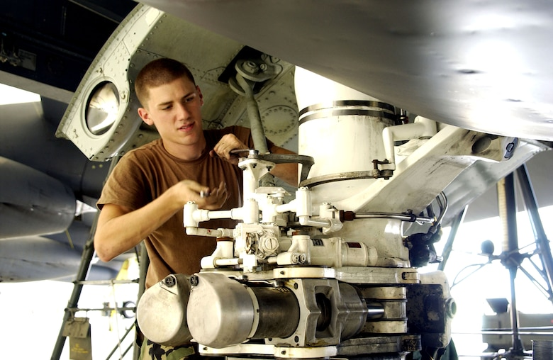Senior Airman Christopher Hirsch works on the landing gear of a B-52 Stratofortress deployed to Andersen Air Force Base, Guam. Airman Hirsch is deployed with the 36th Expeditionary Aircraft Maintenance Squadron, 7,000 miles from his home station at Barksdale AFB, La. The 36th EAMXS has generated more than 110 sorties in support of Pacific theater operations. (U.S. Air Force photo/Senior Master Sgt. Don Perrien)