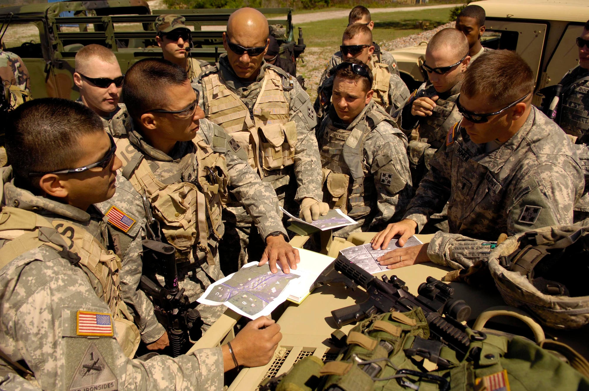 Members of the 4th Infantry Division from Fort Hood, Texas, receive an intelligence briefing before participating in Atlantic Strike V April 16 at Avon Park, Fla. Atlantic Strike is a joint forces training event involving joint terminal attack controllers from the Army, Air Force and Marines and is held semi-annually at the Avon Park Air Ground Training Complex. (U.S. Air Force photo/Staff Sgt. Stephen J. Otero)
