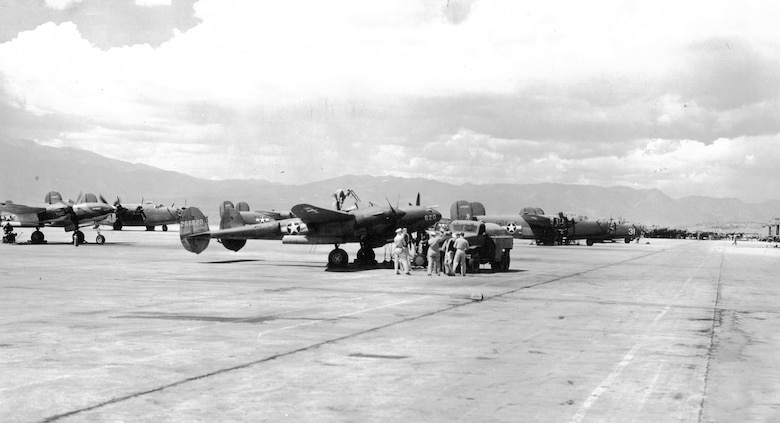 Aircraft crowd the Peterson Field flight line in 1943.  During World War II, Peterson served as a reconnaissance, bomber, and fighter training base. (U.S. Air Force photo)