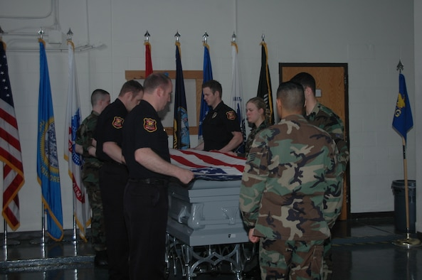 Ellsworth's honor guard wrapped up a four-day training course April 12 which officers from the Rapid City Police Department attended. The group of new honor guard members and local police officers was trained on marching, facing movements, posting the colors, funerals and firing party. It's been nearly two years since the last joint training class was held. (U.S. Air Force photo/Airman 1st Class Kimberly Moore Limrick)