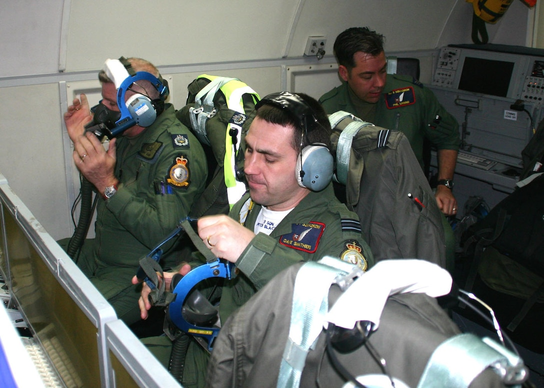 (TINKER AIR FORCE BASE, Okla) No. 8 Squadron members from Royal Air Force Waddington, United Kingdom, Master Aircrew Tony Farmer, left, and Flight Lt. Dave Smathers, right, perform their preflight oxygen mask checks while Sergeant Phil Linning conducts preflight station checks before a mission. Members of the E-3D Sentry squadron conducted a liaison visit to the 552nd Air Control Wing to open the doors for future mission training and partnership. (Photo by Staff Sgt. Stacy Fowler)