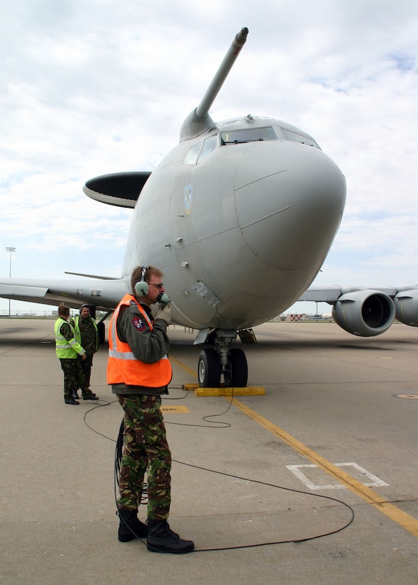 (TINKER AIR FORCE BASE, Okla) Flight Sergeant Steven Webb, one of the No. 8 Squadron maintainers deployed from Royal Air Force Waddington, United Kingdom, with the British E-3D Sentry, stays in contact with the flight deck during the pre-flight inspections before take-off. Members of the E-3D Sentry squadron conducted a liaison visit to the 552nd Air Control Wing to open the doors for future mission training and partnership.(Photo by Staff Sgt. Stacy Fowler)