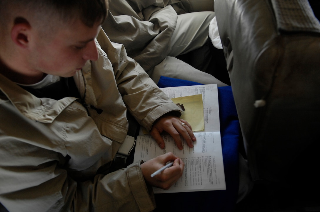 Senior Airman Raymond Testo, USAF Honor Guard Drill Team member, takes a practice test while studying for an upcoming WAPS test on a flight from Andrews AFB. Md., to Los Angeles, Calif., 15 April 2007.  The Drill Team is the traveling component of the Air Force Honor Guard and tours Air Force bases world wide showcasing the precision of today's Air Force to recruit, retain, and inspire Airmen for the Air Force mission. (U.S. Air Force photo by Senior Airman Daniel R. DeCook)(Released)