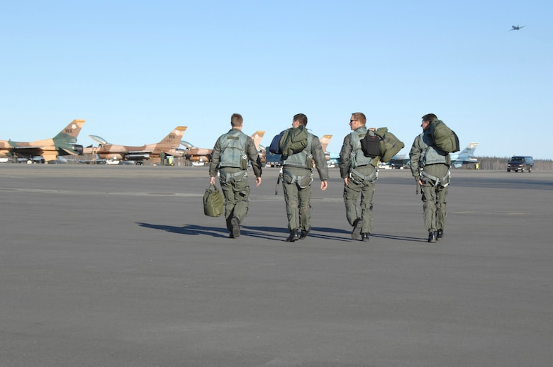 Four F-16 Fighting Falcon pilots step to their jets prior to a mission April 17 during Red Flag-Alaska exercise at Eielson Air Force Base, Alaska. Red Flag-Alaska is a Pacific Air Forces-directed field training exercise for U.S. forces flown under simulated air combat conditions. It is conducted on the Pacific Alaskan Range Complex with air operations flown out of Eielson and Elmendorf Air Force Bases. The Airmen are from the 64th Aggressor Squadron at Nellis Air Force Base, Nevada. (U.S. Air Force photo/Staff Sgt Joshua Strang)