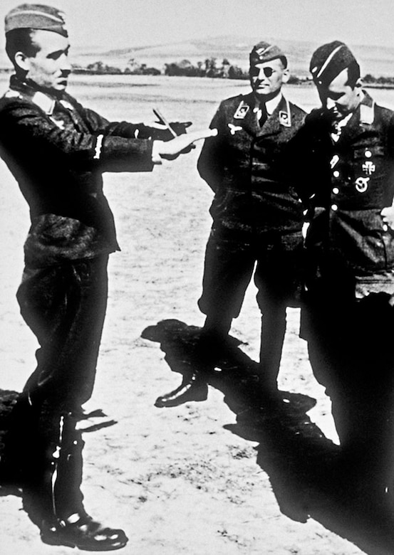 Luftwaffe General of Fighters Adolf Galland describes a dogfight to fellow pilots. (U.S. Air Force photo)