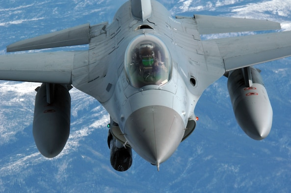 """EIELSON AIR FORCE BASE, Alaska -- An F-16C, 18th Fighter Squadron """"Blue Foxes"""", Eielson Air Force Base, Alaska, pulls in to refuel during a mission here on 18 April in support of Red Flag-Alaska 07-1. The 18th Fighter Squadron conducts air operations for combat-ready F-16 aircraft, working closely with 355th Fighter Squadron to provide close air support, forward air control (airborne), battlefield air interdiction, and offensive counter air. Red Flag-Alaska is a Pacific Air Forces-directed field training exercise for U.S. forces flown under simulated air combat conditions. (U.S. Air Force photo by Staff Sgt. Joshua Strang)"""