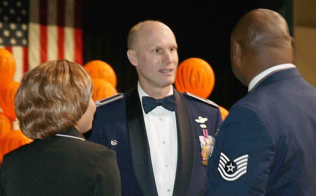 SUMTER, S.C. -- Col. James Post III, 20th Fighter Wing commander, talks to Tech. Sgt. Roosevelt Terry, 79th Aircraft Maintenance Unit, and Sergeant Terry's fiancee, Vernice Glisson, during the 20th Maintenance Group Maintenance Professional of the Year Banquet, April 13 at the Sumter Exhibition Center. The Professional of the Year banquet is held to highlight the contributions of all 20th MXG members and to recognize the most outstanding Airmen within the group. (U.S. Air Force photo/Senior Airman John Gordinier)