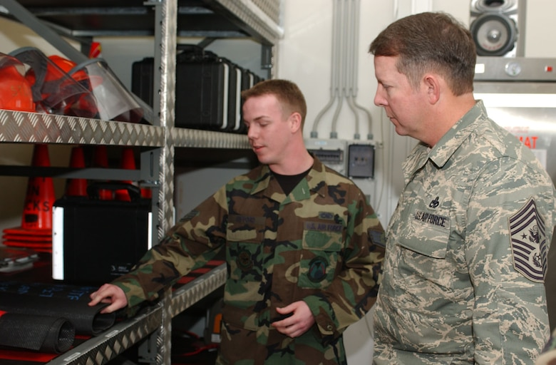 SPANGDHALEM AIR BASE, GERMANY -- Staff Sgt. Olen Gifford, 726th Air Mobility Squadron, explains to Chief Master Sgt. of the Air Force Rodney J. McKinley some of the equipment used by the 726th AMS. (US Air Force photo/Airman 1st Class Stephanie Clark)